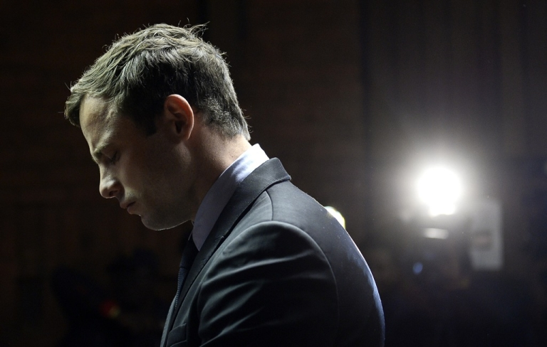 <p>South African Paralympic sprinter Oscar Pistorius appears at the Magistrate Court in Pretoria on August 19, 2013. Pistorius was indicted on charges of murdering his model girlfriend Reeva Steenkamp on February 14. He denies the charge.</p>