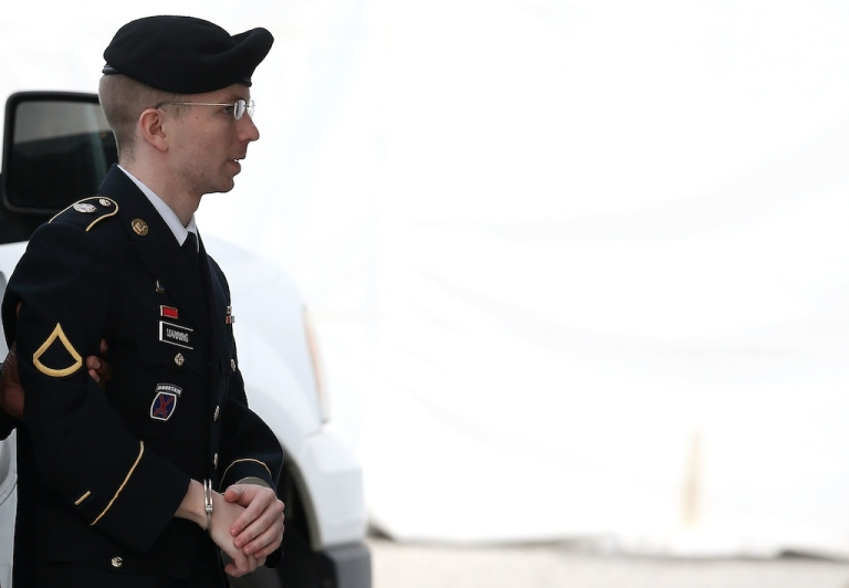 <p>US Army Pvt. Bradley Manning, who wants to be recognized as a woman and now goes by Chelsea, is escorted by military police as she arrives for her sentencing at a military court facility on Aug. 21, 2013.</p>