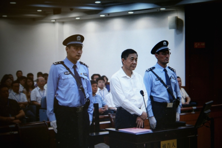 <p>A screen shows a picture of the trial of disgraced Chinese politician Bo Xilai (C) shown at a press conference in Jihua Hotel on August 22, 2013 in Jinan, China. Bo is standing trial on charges of bribery, corruption and abuse of power.</p>