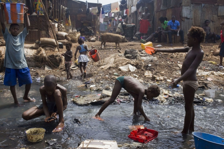 <p>Young children retrieve anything of value from the Crocodile River in the slums of Kroo Bay in Freetown, Sierra Leone.</p>
