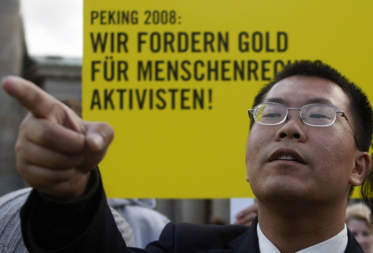 <p>Chinese human rights lawyer Biao Teng gestures during a demonstration by activists from the German chapter of Amnesty International in Berlin 07 December 2007. Mr. Teng speaks to GlobalPost in an exclusive interview.</p>