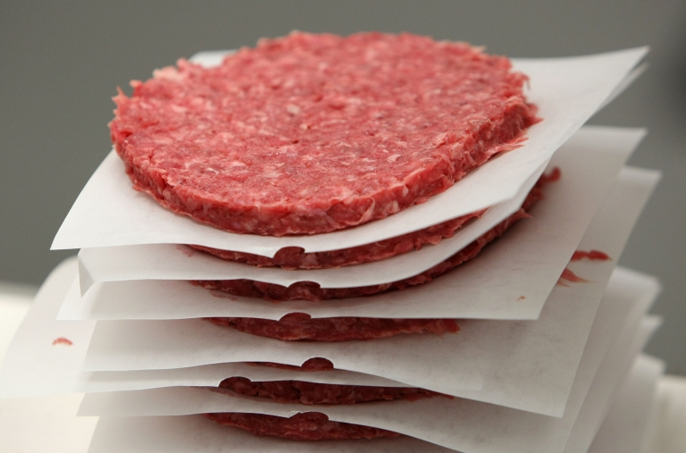 <p>A stack of ground beef patties moves on a conveyor belt at a meat packing and distribution facility June 24, 2008 in San Francisco, California. In-virto beef created by the University of Maastricht has been successfully prepared for taste-testing.</p>