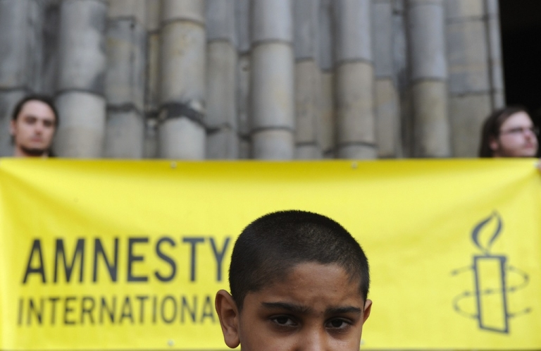 <p>A Roma boy is pictured at a rally against extremism and neo-Nazism on May 3, 2009 in Prague.</p>