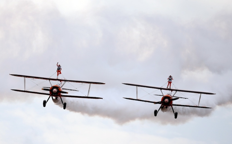 <p>Nine-year-old cousins Rose Powell, left, and Flame Brewer wing-walk over Rendcomb airfield in Gloucestershire, England, on Aug. 21, 2013 in an attempt to become the world's youngest formation wing-walkers.</p>