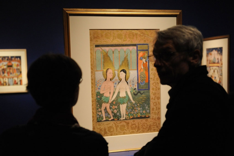 <p>Patrons view an early 17th century Ottoman painting of Adam and Eve at the Smithsonian Sackler Gallery of Art on October 27, 2009 in Washington.</p>
