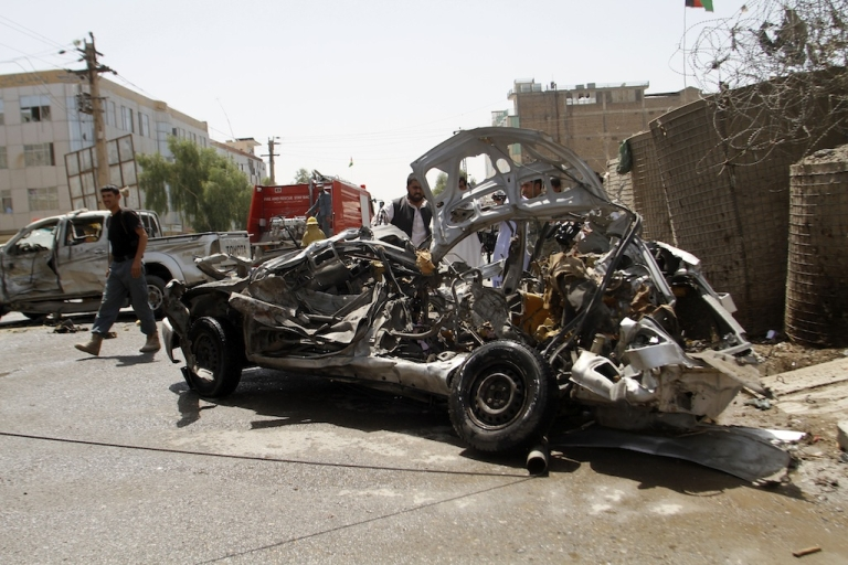 <p>The mangled wreckage of a vehicle is seen at the site of a suicide attack in Kandahar on August 31, 2013. At least six Afghans were killed and 20 others wounded on Saturday morning after suicide attacker targeted police in southern Kandahar city, officials said.</p>