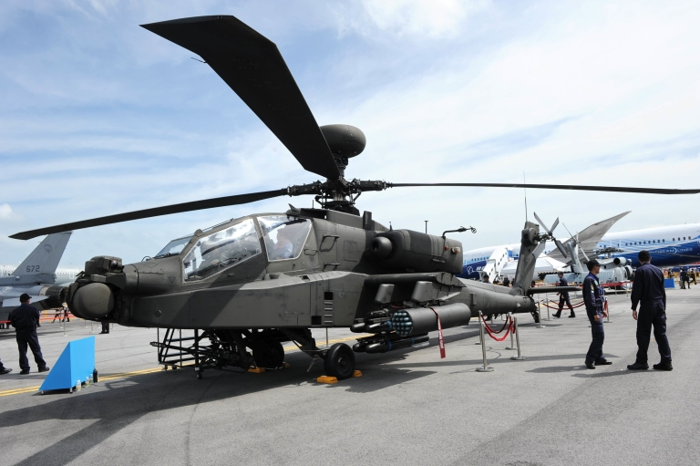 <p>A Boeing AH-64D Apache helicopter is displayed at the Singapore Airshow in Singapore on Feb. 14, 2012. The US has agreed to sell Indonesia eight AH-64E Apaches for $500 million.</p>