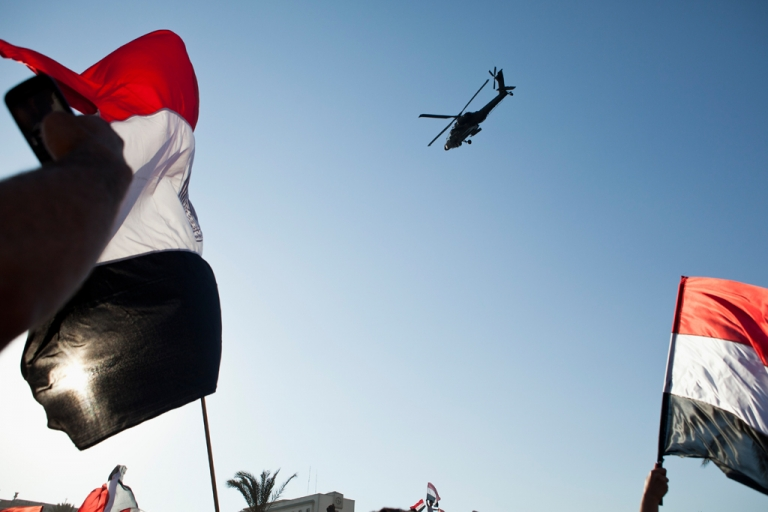 <p>CAIRO, EGYPT - JULY 26: An Egyptian Army Apache helicopter flies over a crowd of pro-military demonstrators at Tahrir Square on July 26, 2013 in Cairo, Egypt. Congress is divided over cutting off the $1.5 billion in annual aid to Egypt. Much of the money is used to finance the purchase of American military equipment.</p>