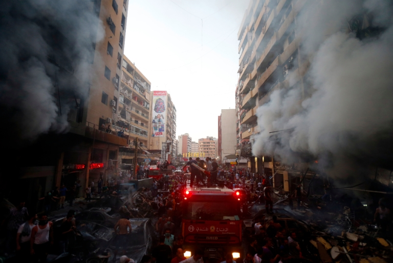 <p>Lebanese civilians and emergency personnel gather at the site of a car bomb between the Bir el-Abed and Roueiss neighbourhoods, in the southern suburb of Beirut on August 15, 2013.</p>