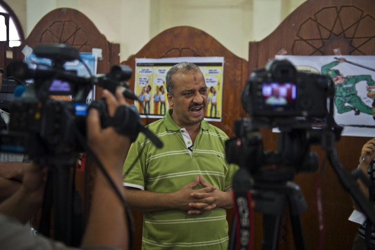 <p>A picture taken August 4, 2013 shows Egypt's Muslim Brotherhood leader Mohamed al-Beltagi talking with foreign media during an interview at the Rabaa al-Adawiya mosque in Cairo. Beltagi is the latest top-ranking member of the Brotherhood to be arrested for inciting violence.</p>