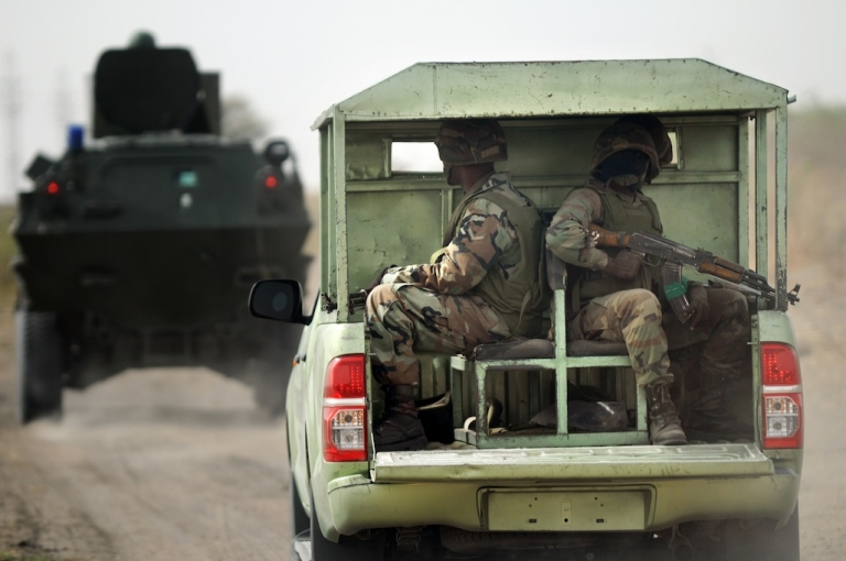 <p>Nigerian soldiers patrol in the north of Borno state close to a former Boko Haram camp on June 5, 2013, near Maiduguri.</p>