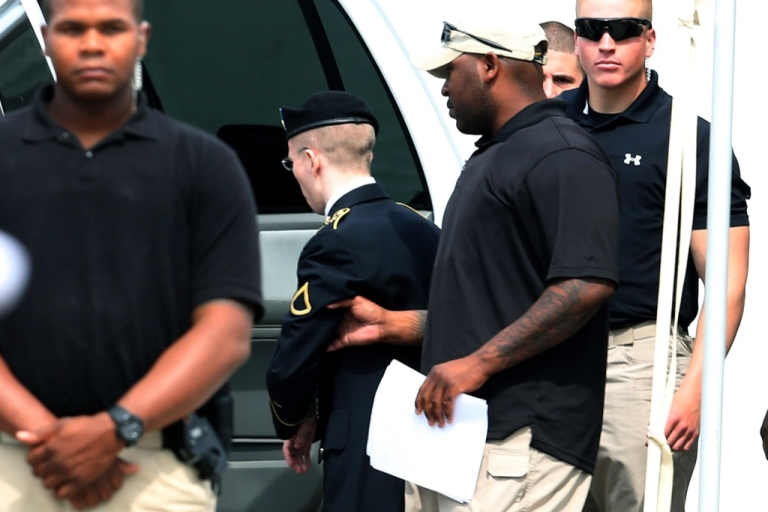 <p>US Army Private First Class Bradley Manning is escorted by military police after he was sentenced to 35 years in prison on Aug. 21, 2013 in Fort Meade, Maryland. Manning was also dishonorably discharged after he was found guilty of several counts under the Espionage Act. He was acquitted of the most serious charge of aiding the enemy.</p>