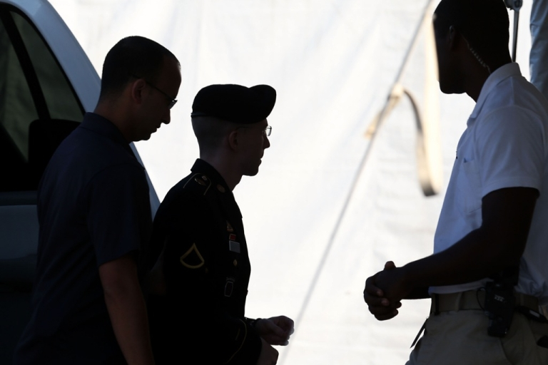 <p>US Army Private First Class Bradley Manning (C) arrives at a military court facility for the sentencing phase of his trial on Aug. 14, 2013 in Fort Meade, Maryland. Manning was found guilty of several counts under the Espionage Act, but acquitted of the most serious charge of aiding the enemy.</p>