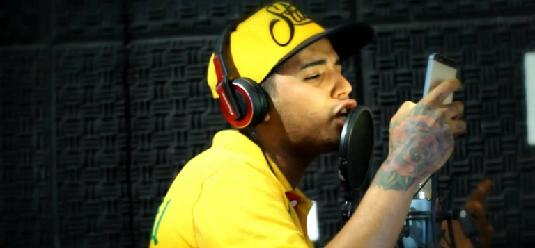 <p>Brazil's MC Daleste on the microphone in a still from a music video.</p>
