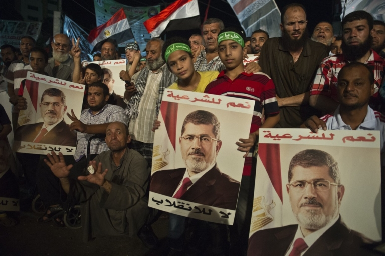 <p>Supporters of Egypt's deposed president Mohamed Morsi gather during a sit-in outside Rabaa al-Adawiya mosque in Cairo on August 1, 2013.</p>