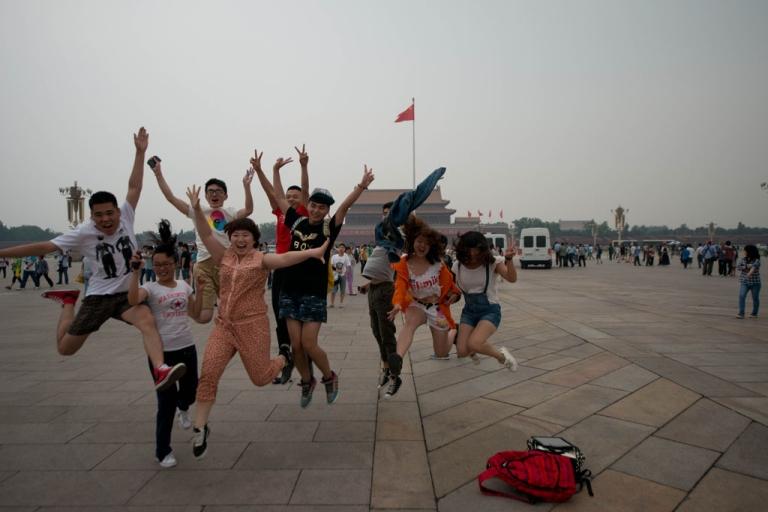 <p>Tourists in Tiananmen square in Beijing, June 4, 2013.</p>