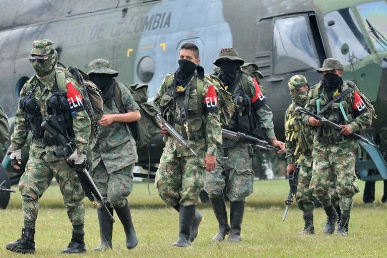 <p>Demobilized members of the ELN (National Liberation Army) arrive in Cali, Colombia, on July 16, 2013. Thirty members of the ELN surrendered with their weapons.</p>