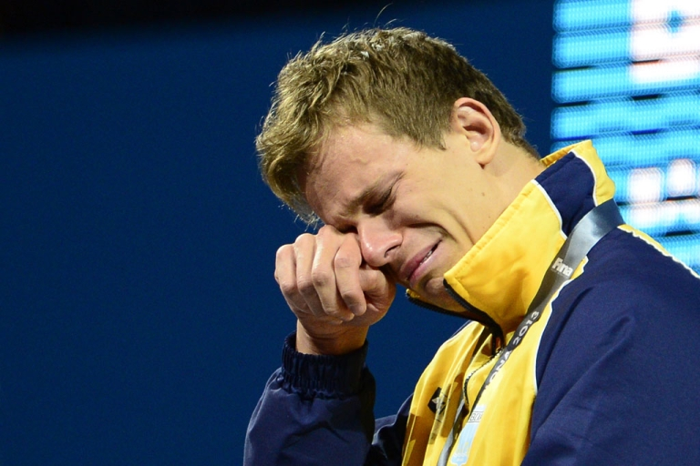 <p>Brazil's Cesar Cielo Filho wipes away tears during an award ceremony for the men's 50-metre freestyle gold at the world swimming championships in Barcelona on August 3, 2013.  While Filho's tears are those of joy, new research suggests men and women are depressed in equal numbers, although men are less likely to show their emotions.</p>