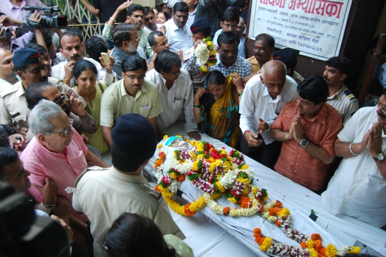 <p>Mourners pay their respects over the casket of anti-superstition and anti-black magic campaigner Narendra Dabholkar, who was killed in Pune, India, on Aug. 20, 2013.</p>