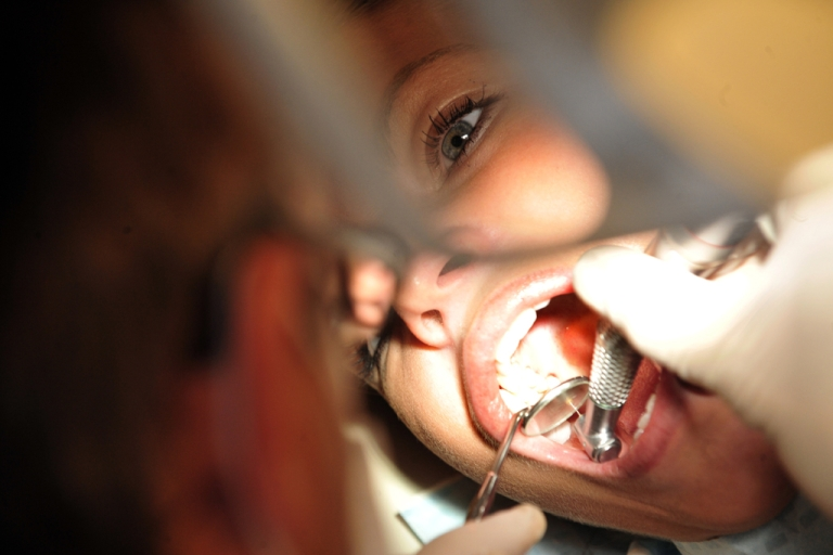 <p>A Hungarian dentist treats a patient in his office in Budapest on Dec. 30, 2010.</p>