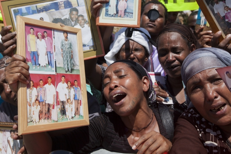 <p>Israelis from the Ethiopian community hold photographs of their relatives during a protest outside Prime Minister Benjamin Netanyahu's office in Jerusalem on Aug. 28, 2013.</p>