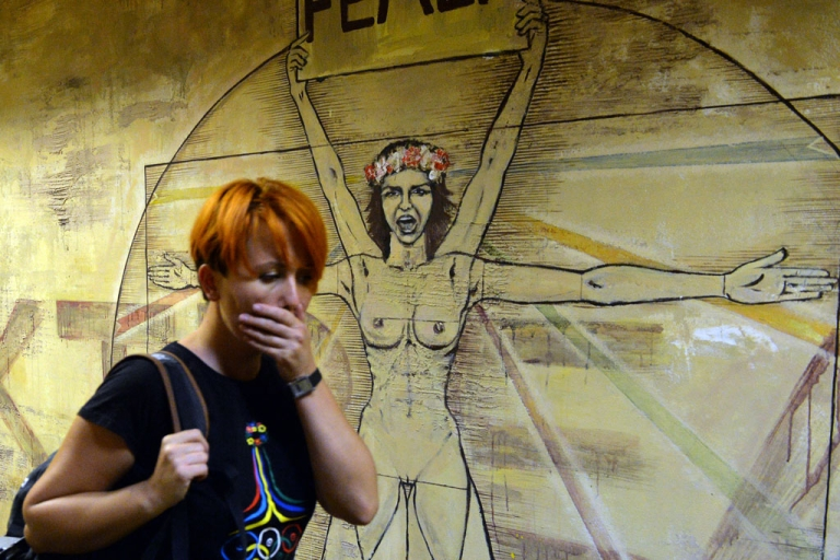 <p>Femen leader Anna Hutsol leaves her Kiev office after a police search on Aug. 27, 2013. Police said they found a gun, grenade, portraits of Russian President Vladimir Putin and Patriarch Kirill. Hutsol said it was a provocation organized by the security services against the organization.</p>