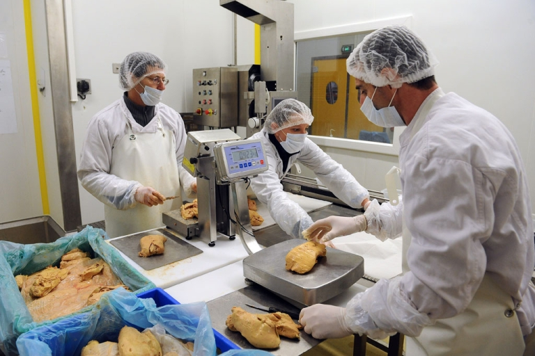 <p>Workers prepare foie gras in a laboratory in Cahors, France, on February 28, 2013.</p>