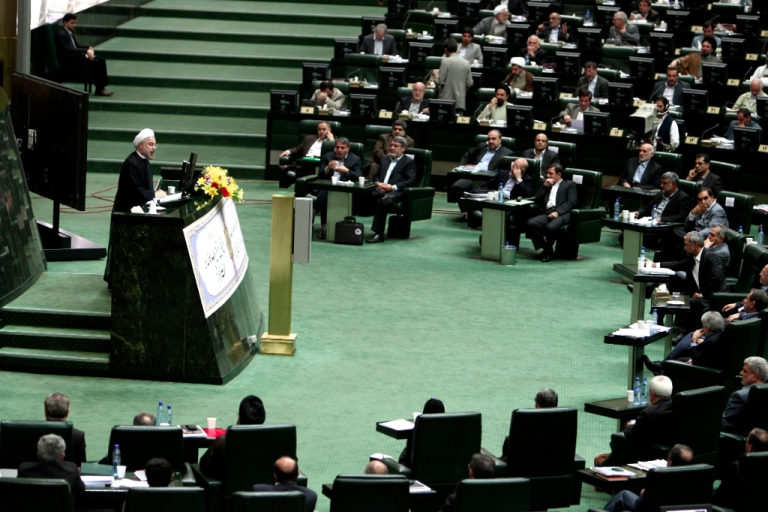 <p>Iranian President Hassan Rouhani speaks during a parliament session to elect the cabinet members on August 15, 2013 in Tehran. Iran MPs approve 15 of Rouhani's 18 cabinet picks.</p>