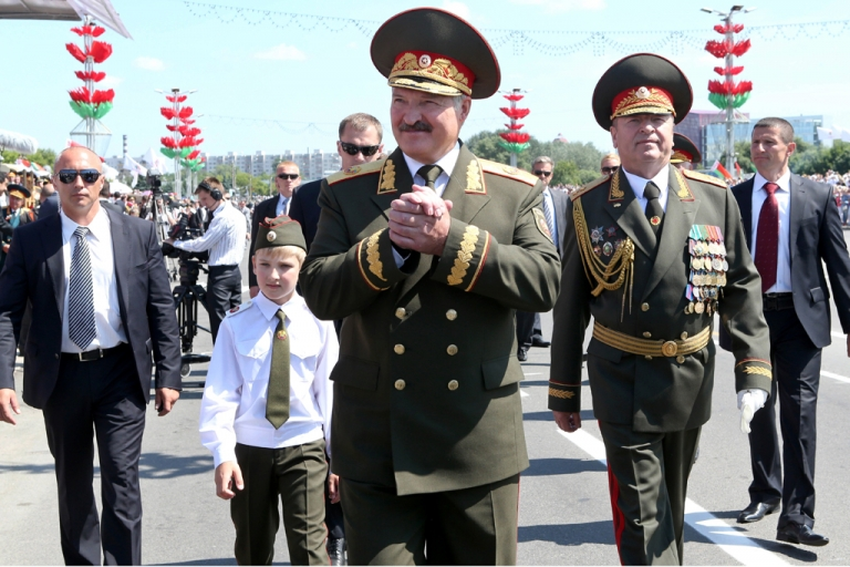 <p>Belarus' president, Alexander Lukashenko, center, and his son Kolya attend Independence Day parade in Minsk, on July 3.</p>
