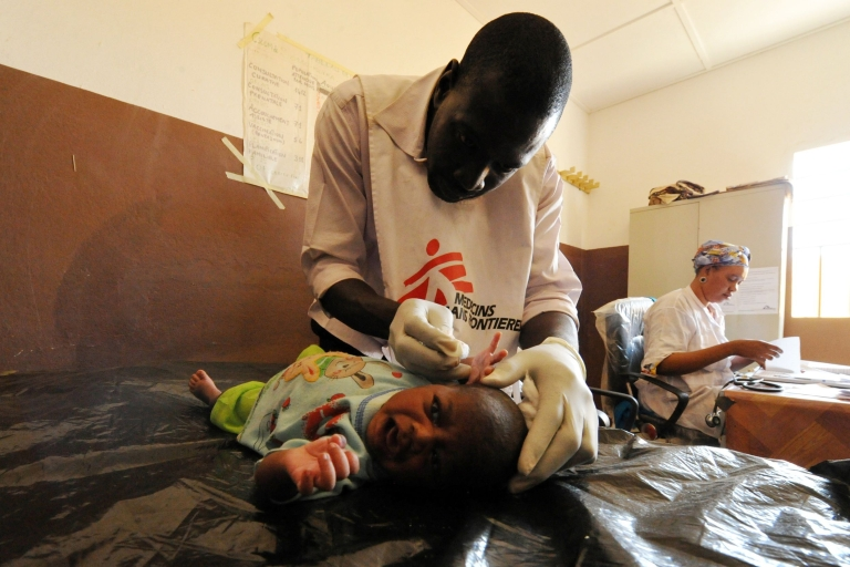 <p>A worker from the NGO Doctors Without Borders examines a sick baby in Gao, in the north of Mali, on February 4, 2013.</p>