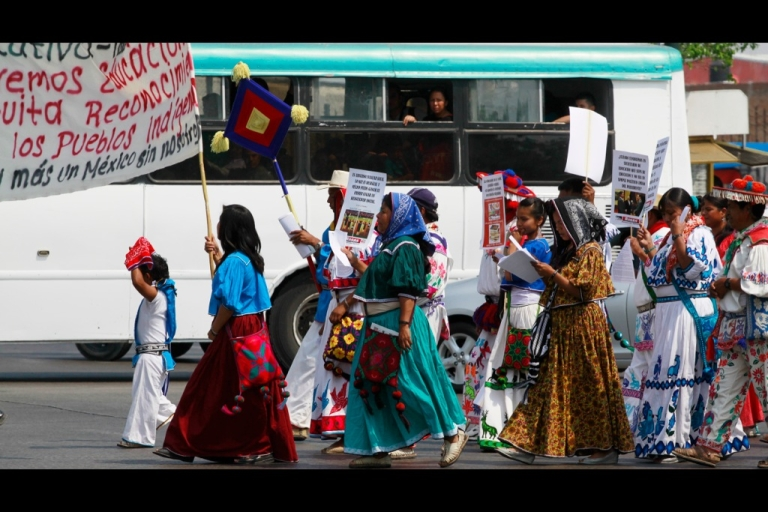 <p>Indigenous Wixarikas teachers shout slogans during a protest in Guadalajara City, Mexico on May 15, 2013. The teachers protested against educational reforms proposed by the Mexican government.</p>
