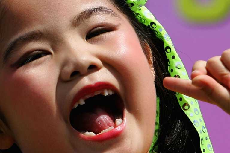 <p>A child sings during an International Children's Day celebration in Beijing, China.</p>