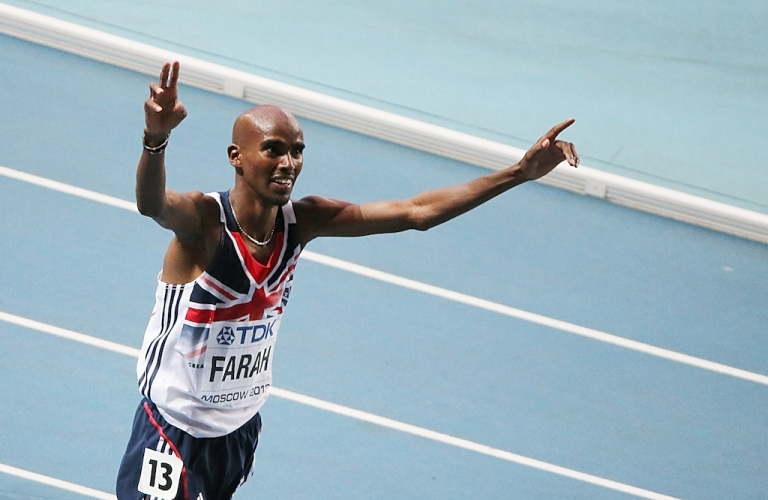 <p>Britain's Mo Farah celebrates after winning the men's 5000 metres final at the World Athletics Championships in Moscow on August 16, 2013.</p>