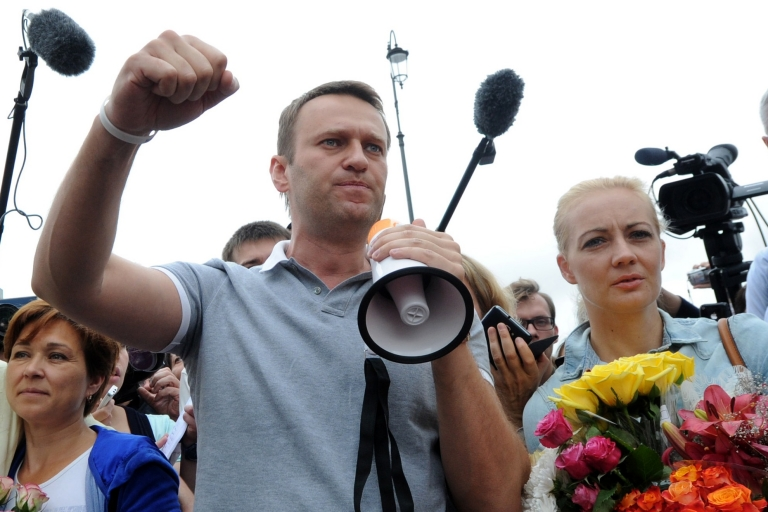 <p>Navalny with his wife Yulia. The opposition leader hasn't shied away from campaigning against the authorities in the face of their curious treatment of him.</p>