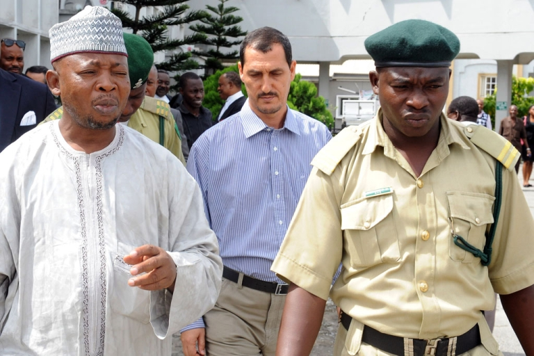 <p>An alleged member of the Iranian Revolutionary Guard, Azim Aghajani and his Nigerian accomplice Ali Abbas Jega are led to prison on May 13, 2013 after being convicted for an illegal arms shipment in Lagos. Nigerian authorities are growing concerned about an apparent surge in interest in the West African country by Shia Muslim militant groups with links to Iran or Lebanon</p>