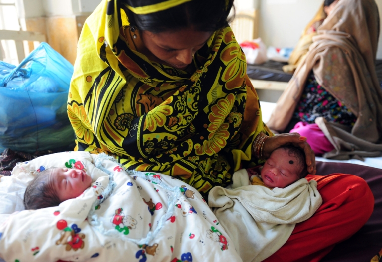 <p>Pakistani mother Shabana tends to her new born baby twins at a government hospital in Karachi. A recent provocative condom commercial has health workers worried it will hinder their efforts to educate women about contraception.</p>