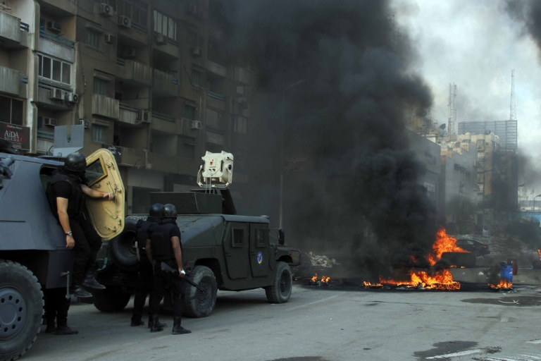 <p>Egyptian security forces move in to disperse a protest camp held by supporters of ousted president Mohamed Morsi and members of the Muslim Brotherhood, on August 14, 2013 near Cairo's Rabaa al-Adawiya mosque.</p>