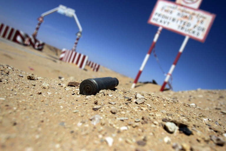 <p>An empty bullet shell is seen outside the entrance of the al-Ghani oil field, belonging to Libya's Harouge Oil Operations company, near the city of Waddan in the central Al-Jufrah province on March 23, 2013. Libya plans to invite bids from foreign firms for oil concessions by the end of 2013 as Tripoli wants to increase its OPEC output quota despite conflict with armed militias, strikes and allegations of corruption.</p>