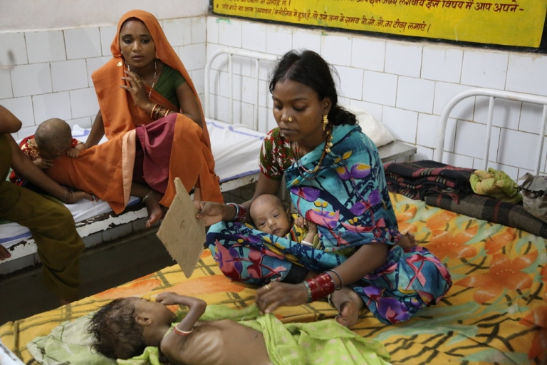 <p>A mother uses a hand-fan for her 3-year-old daughter Deekhsha, suffering from chronic malnutrition at the District Hospital in Panna, Madhya Pradesh in Central India.</p>