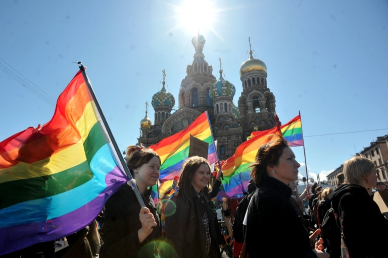 <p>Gay rights activists march in Russia's second city of St. Petersburg May 1, 2013, during their rally against a controversial law in the city that activists see as violating the rights of gays.</p>