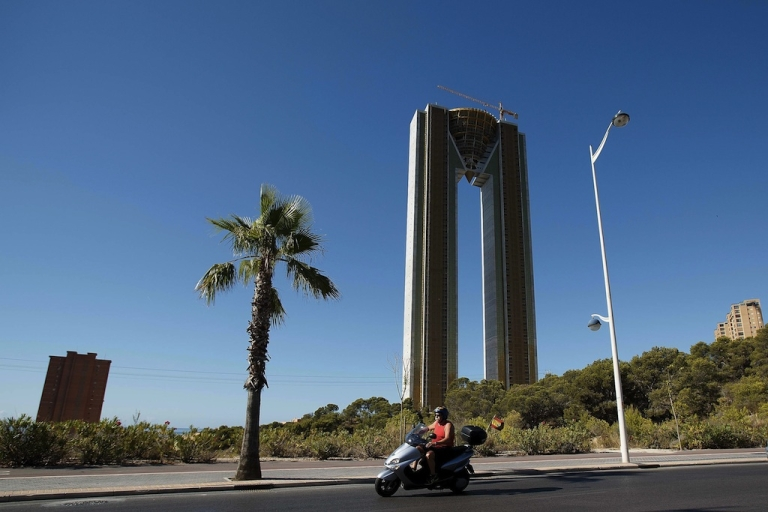 <p>A man rides a motorbike past the InTempo building on August 9, 2013 in Benidorm, Spain. The construction of the In Tempo building began during the economic boom and was meant open in 2009 as the tallest residential building within the EU. However after a catalogue of problems the 47-story twin tower building remains unfinished.</p>