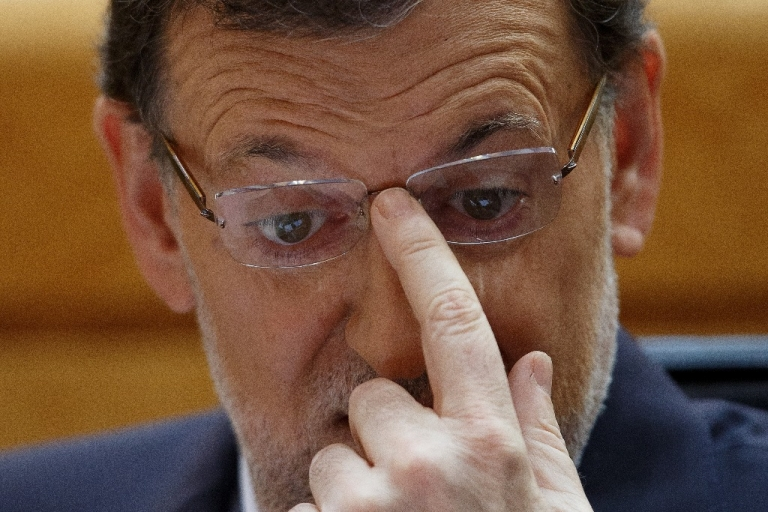 <p>MADRID, SPAIN - AUGUST 01: Spanish Prime Minister Mariano Rajoy (Popular Party leader) attends a parliament session to speak over allegations on corruption scandals on August 1, 2013 in Madrid, Spain. Rajoy admitted he made a mistake in trusting his former party treasurer Luis Barcenas but denied doing anything wrong himself.</p>