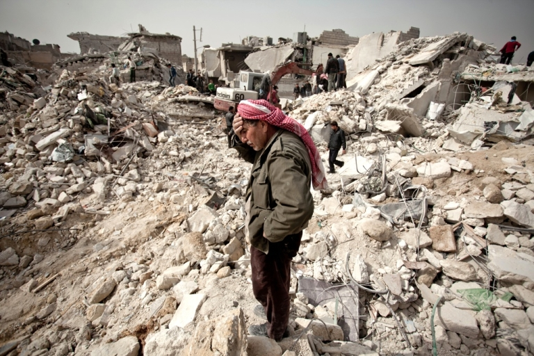 <p>A Syrian man stands where his home once was in the Tariq al-Bab district of the northern city of Aleppo.</p>