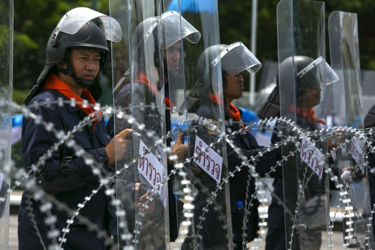 <p>Thai riot police stand guard near Parliament during an anti-government protest on August 7, 2013 in Bangkok. Opposition to Yingluck Shinawatra's government gathered to protest against an amnesty bill.</p>
