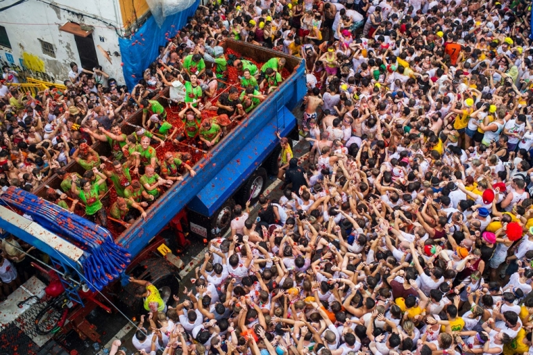 <p>People on six trucks pelted the crowd with 130 tons of ripe tomatoes at the Tomatina festival on Aug. 28, 2013.</p>