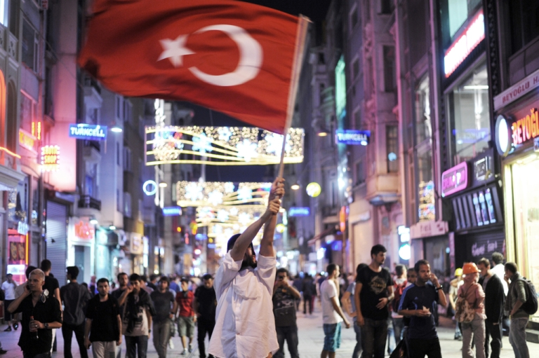 <p>An anti-government demonstrator waves a flag on June 17, 2013 on Istikal street in the center of Istanbul.</p>