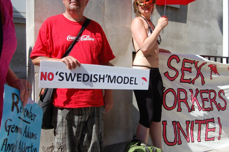 <p>Demonstrators in front of the Swedish Embassy in London last month protested the country's prostitution laws after a sex worker was murdered there.</p>