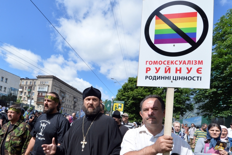 <p>Anti-gay protesters in Kyiv. The sign reads