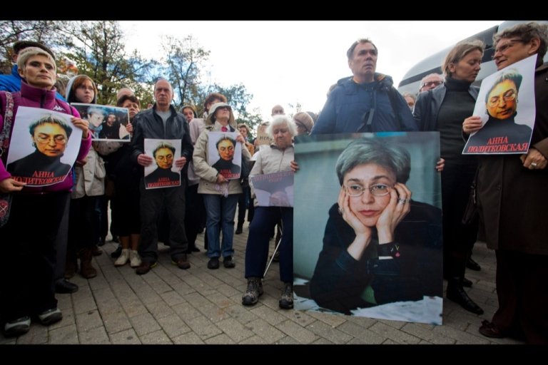 <p>Demonstrators hold portraits of slain journalist Anna Politkovskaya during a rally marking the 6th anniversary of her death in central Moscow on Oct. 7, 2012.</p>