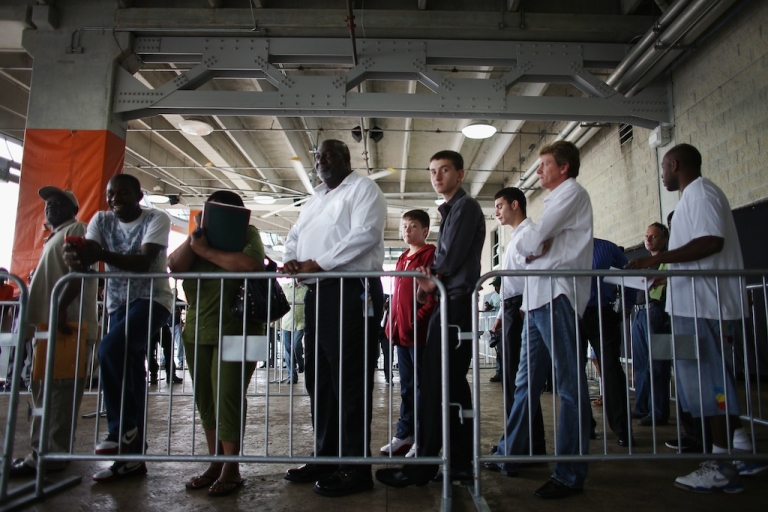 <p>People looking for work stand in line to apply for a job during a job fair at the Miami Dolphins Sun Life stadium on May 2, 2013 in Miami, Florida.</p>